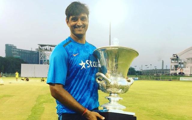 Pankaj Singh posing with a trophy