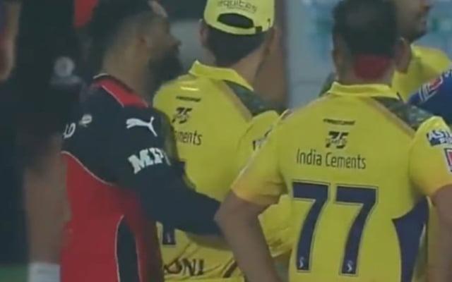 Virat Kohli hugging MS Dhoni from behind